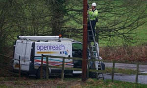 An Openreach worker attaches cables to a tree