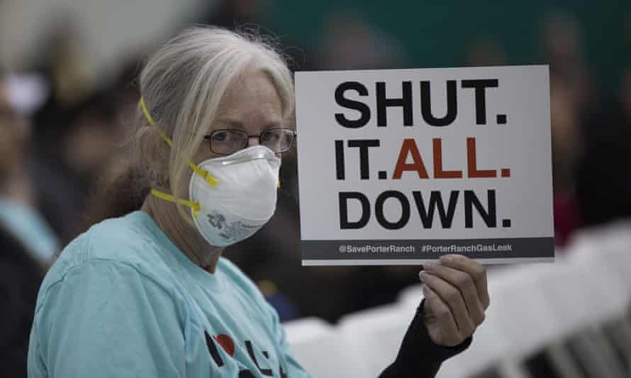 A protester at a public hearing before the South Coast Air Quality Management District in southern California. The Aliso Canyon leak has spewed 80,000 metric tons of methane since October, displacing thousands. Now experts say smaller, more frequent leaks across the US pose a greater threat