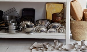 A board of drying clay pots in the kitchen.