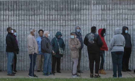 US-VOTE-OHIO<br>Residents of Lucas County, Ohio wait in line to cast their vote during early voting in the US state of Ohio on October 6,2020 in Toledo, Ohio. (Photo by SETH HERALD / AFP) (Photo by SETH HERALD/AFP via Getty Images)