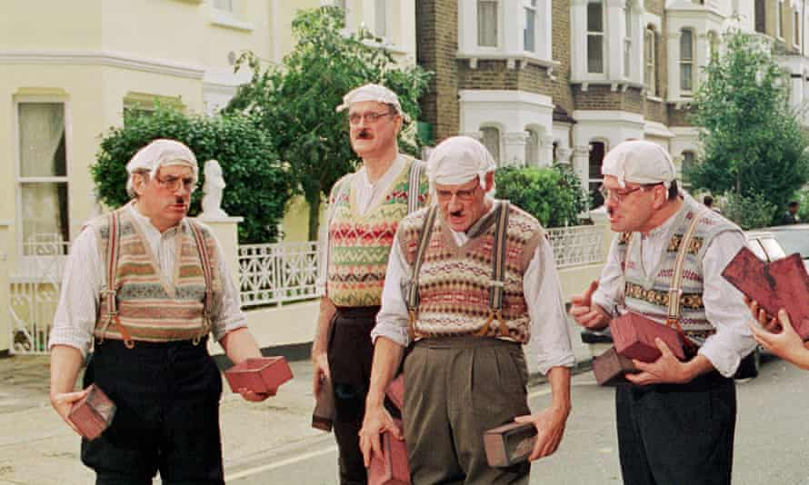 From left, Terry Jones, John Cleese, Michael Palin, Terry Gilliam and Eddie Izzard dressed as Gumbies in 1999.