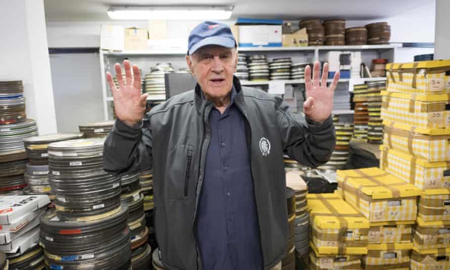Rémy Julienne in front of film reels
