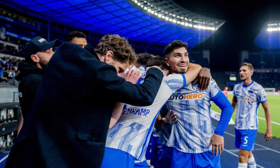 Hertha's players celebrate on the touchline after their win.