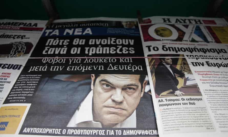 Greek newspaper headlines depicting the Greek PM Alexis Tsipras, along with Syriza's newspaper Avgi, with a banner reading 'NO' (OXI).