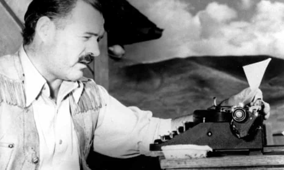 Ernest Hemingway at his typewriter as he works on For Whom the Bell Tolls at Sun Valley lodge, Idaho, in 1939.