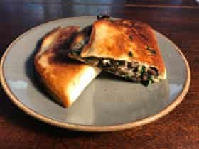 J Kenji Lopez Alt's quesadilla: swiss cheese, spinach and black beans: 'the cosmic oneness theory of quesadillas'.
