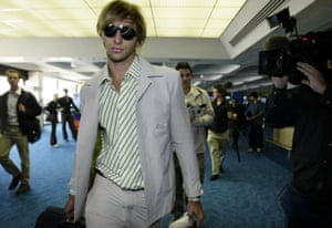Ian Thorpe beats a hasty path past the media en route to the 2004 Athens games.