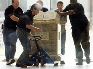Workmen remove the monument of the Ten Commandments that Moore installed in the Alabama judicial building.