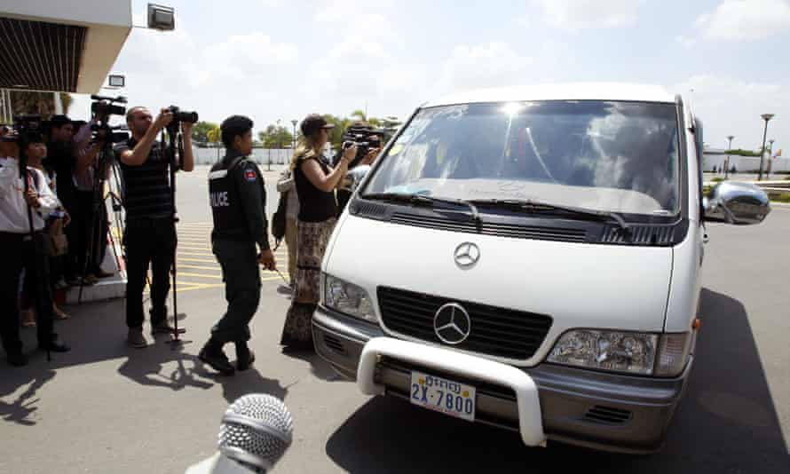A photo from June showing the first four refugees from Nauru arriving at Phnom Penh airport.