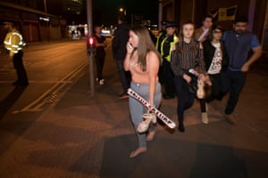 Concert goers react after fleeing the Manchester Arena