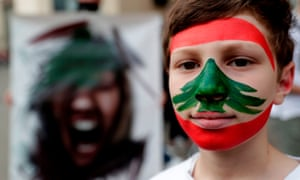 A boy takes part in anti-government demonstrations in Beirut on Saturday.