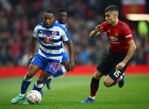 Callum Harriott of Reading surges forward past Andreas Pereira of Manchester United.