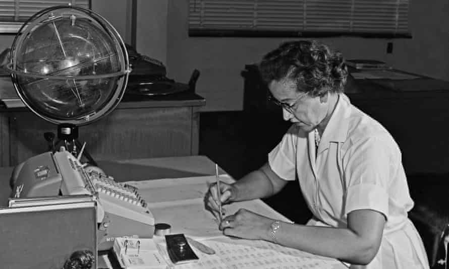 Katherine Johnson with an adding machine and a 'celestial training device' at her desk at Nasa's Langley research centre in 1962