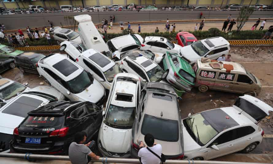 Torrential Rains Hit HenanZHENGZHOU, CHINA - JULY 22: Damaged cars sit on a muddy road at the entrance of an expressway tunnel on July 22, 2021 in Zhengzhou, Henan Province of China. Torrential rains hit Henan since July 16, causing floods in many parts of the province on Monday and Tuesday. (Photo by Bai Zhoufeng/VCG via Getty Images)