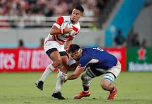 Japan's Yu Tamura in action with Russia's Vitaly Zhivatov.