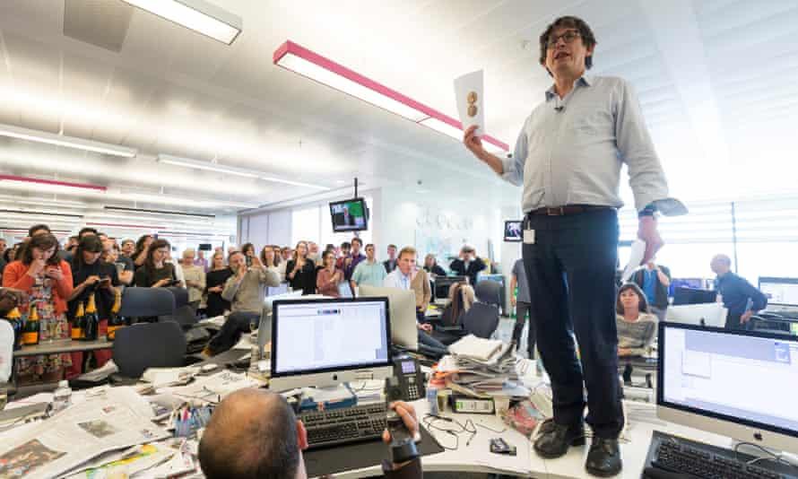 Alan Rusbridger standing on a desk