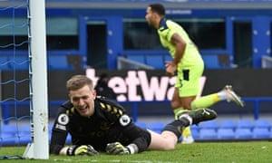 Everton's goalkeeper Jordan Pickford reacts as Newcastle United's Callum Wilson celebrates scoring the opening goal.