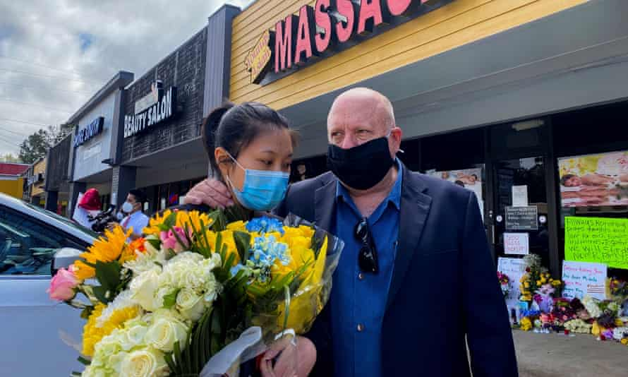 Jami Webb, the daughter of Xiaojie Tan, who was killed in Tuesday's shootings, is consoled by her father Michael Webb outside Youngs Asian Massage in Acworth, Georgia.