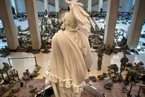 Members of the National Guard rest in the Capitol Visitors Center on Wednesday.