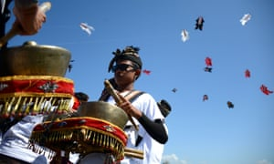 Balinese men perform traditional music during a kite festival in Denpasar