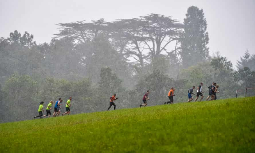 Runners on a hill