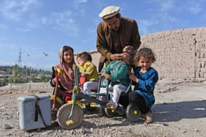 A health worker administers Polio vaccine to a child in the border region of Nangarhar, Afghanistan.