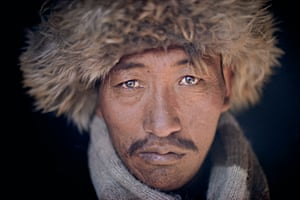Caravaneer Shakir's eyes reflect the colours of the mountain, Afghanistan