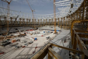 Construction work continues on the roof structure around the main bowl at the Al Rayyan stadium.