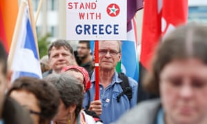 People attend a rally in support of Greece in Brussels on Wednesday.