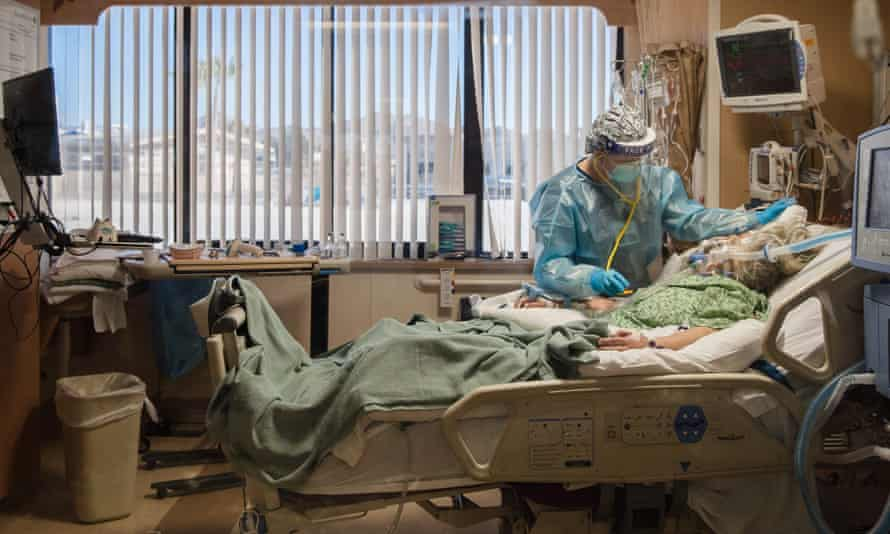 A nurse cares for a Covid patient in intensive care at Providence St Mary Medical Center in Apple Valley, California.