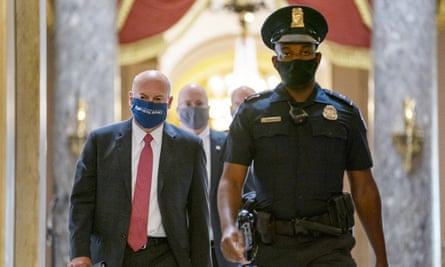 Louis DeJoy, left, on Capitol Hill in Washington DC, on 5 August.