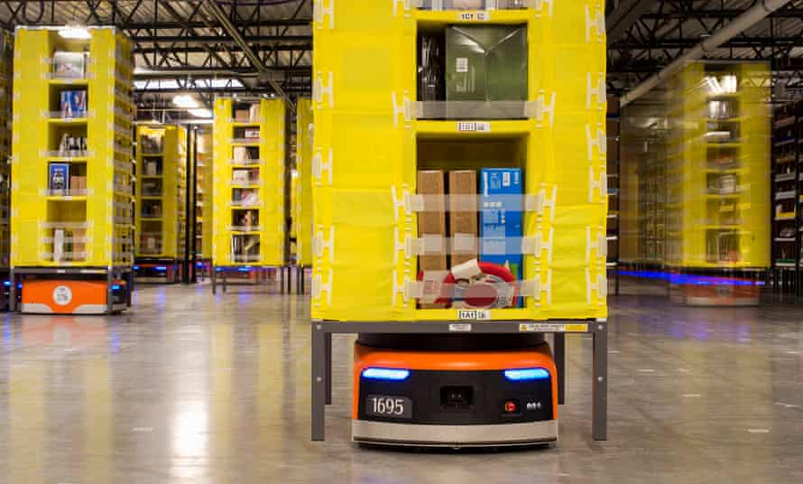 Robots move inventory at an Amazon fulfilment warehouse. Amazon installed more than 15,000 robots across 10 US warehouses, a move that promises to cut operating costs by one-fifth.