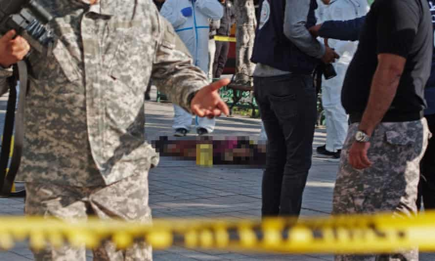 The suspected suicide bomber's body is surrounded by a police cordon.