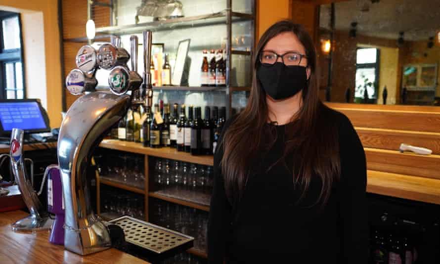 Masked landlady in pub