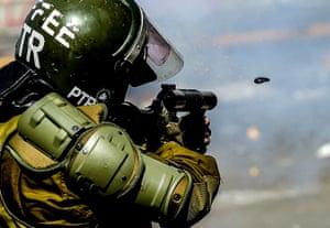 Riot police fire tear gas