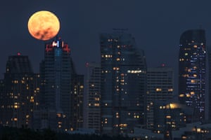 The moon hangs over the Maslak businesses district in Istanbul, Turkey.