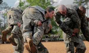 Then US army first lieutenant Kirsten Griest participates in combatives training during the ranger course on Fort Benning, in Georgia.