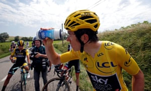 Geraint Thomas rinses his eyes after inadvertently being hit by police pepper spray.