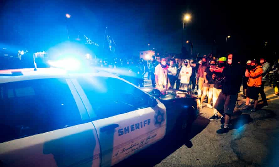 Protesters block a sheriff's car as they demonstrate following the death of a black man in south Los Angeles, California Monday.