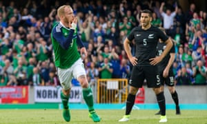 Liam Boyce celebrates his first Northern Ireland goal as New Zealand's Michael Boxall watches on.