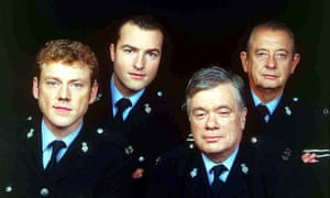 William Simons as PC Alf Ventress, second right, with from left: PC Phil Bellamy (Mark Jordon), PC Nick Rowan (Nick Berry) and Sgt Oscar Blaketon (Derek Fowlds) in Heartbeat, 1995.