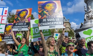 People hold placards at climate march in Paris, 2014