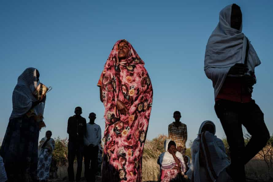 An Ethiopian refugee from the Tigray conflict attends mass at a refugee camp in eastern Sudan.