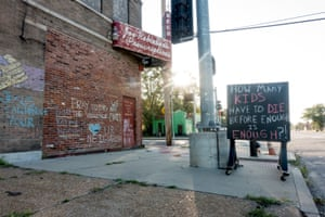 An abandoned building is adorned with chalk art pleading for an end to violence in north St. Louis on Saturday, Sept. 14, 2019. At least 13 children have died of gunshot wounds in St. Louis city this year, and six children in St. Louis Country have been killed by gunfire.