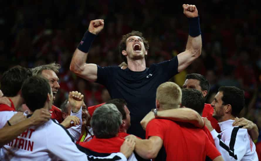 29-11-2015 of Great Britain's Andy Murray is hoisted up by his teammates as they celebrates winning the Davis Cup after winning against Belgium's David Goffin during day three of the Davis Cup Final at the Flanders Expo Centre, Ghent. PA