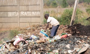 A boy searches for plastic waste and cardboard for resale in the Warren Park Township in Harare.  Zimbabwe's economic crisis means that there is no treatment for the majority of drug addicts.