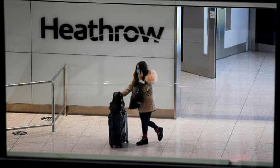A traveller arrives at Heathrow airport, London.