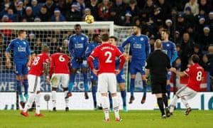 Manchester United's Juan Mata scores from a set piece.