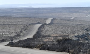 Roads winding through the charred vegetation have been coated with ash