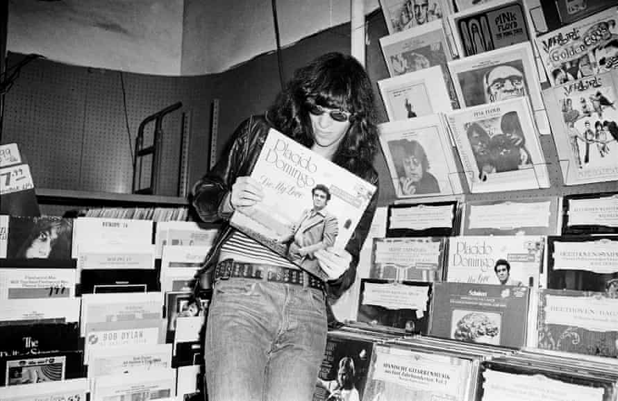 Joey Ramone goes record shopping at Free Being Records in New York.